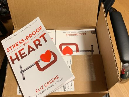 A box of new books on stress and heart health from author Eliz Greene